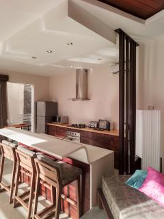 It consists of one spacious living and dining area, an open space kitchen, entertainment room
