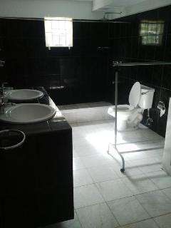 bottom poolside appartment  bathroom/showere with white marble floor,,twin basin
