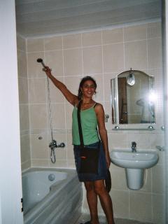 Clean, modern and stylish bathroom, with a washing machine hidden away.