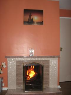 Cosy log fire available in the winter months.