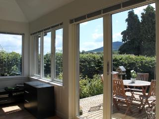 Orchard cottage, with views from the patio seating to the Eildon hills beyond.