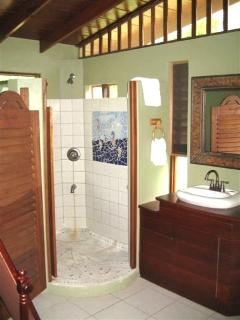Large modern bathrooms complemented by local artists