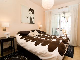 The master bedroom features a double bed, safe, and en-suite bathroom