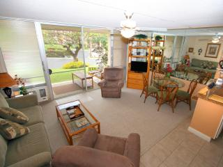 Living Room with 2 Recliners, A/C, Ceiling fan and sliding door to the lanai.