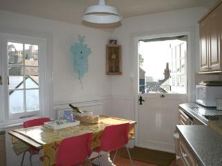 View into the kitchen, with stable door opening onto balcony