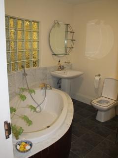 Main Bathroom with huge oval bath and spacious shower
