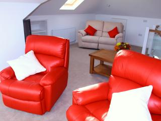 Large Upstairs TV Lounge with stunning views, ideal for party's and drinks.