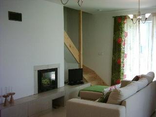Beautifully furnished lounge is bright & spacious