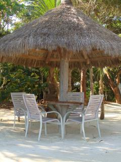 Seabird's beach comes complete with hammocks, chickee huts, white sand, and coconut palms!