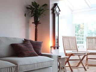 The living room space ends in a bright conservatory and opens out onto the decking and garden