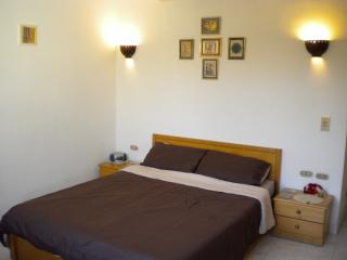 Large bedroom with kingsize bed and single bed (not shown)