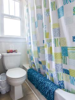 brightly lit full bathroom