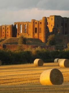 A summer sunset of Kenilworth Castle from the farm