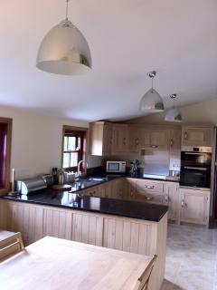 Our lovely oak and granite kitchen