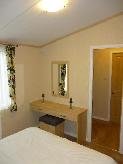 Master bedroom view of walk-in and en-suite