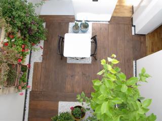 F12 NI - apartamento design con jardín de invierno