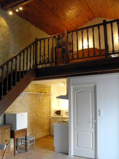 Stairs to mezzanine, double bed and wardrobe