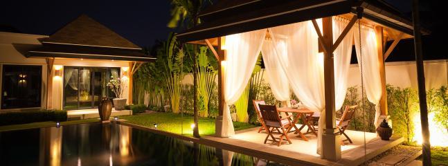 Villa beautifully lit at night
