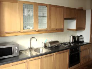 Kitchen with washing machine, dishwasher, fridge/freezer, microwave, kettle, cafetiere and toaster.