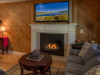 Warm up by the gas fireplace and watch your favorite movie on this humongous TV!