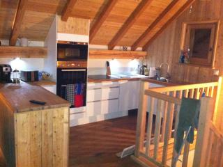 Fully equipped open plan  kitchen with full oven, coffee machine, dishwasher,