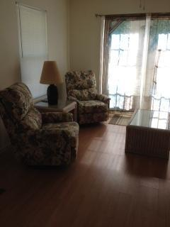 Living room/kitchen, french doors leading to deck.TV, wi-fi, Fully equipped kitchen.