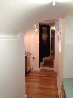 view of utility area and hallway to wetroom, bedroom & front room