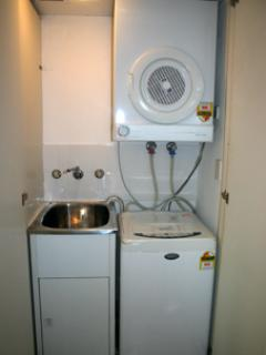 Private laundry facilities with tumble dryer, drying rack and Iron