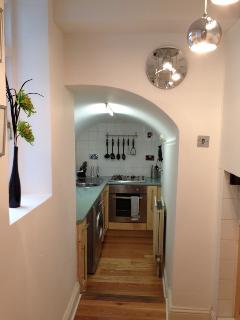 Vaulted lower kitchen overlooking garden area.