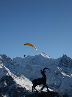 Christmas day paragliding in front of the Zinal Rothorn