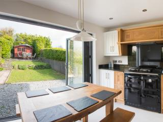 Kitchen, bifold doors open to a completely enclosed rear garden