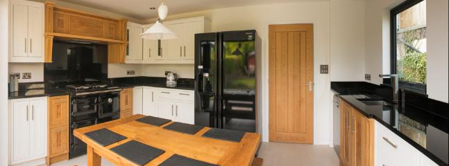 Breakfast kitchen with Aga Rayburn, American Style fridge/freezer & KitchenAid appliances