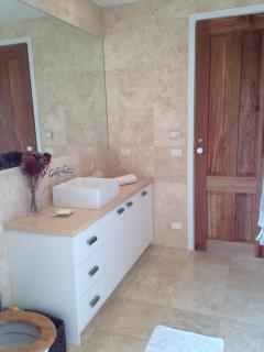 Bathroom with underfloor hearing and marbles tiles