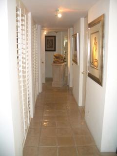 Corridor / walls of Art lead to bedrooms