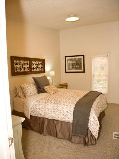 Second bedroom offers queen bed and large closet