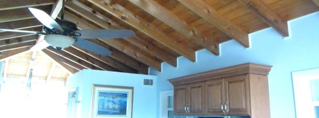 Aromatic authentic cedar beam ceilings with 60' ceiling fan in presidential suite.