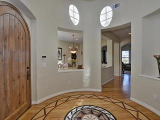 Rounded entry with custom door w/ center marble medallion and overhead rotunda