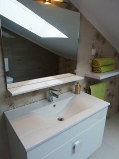 Spacious bathroom where you can make yourself look and feel beautiful!