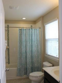 Jack and Jill Full bath with double sinks. Connects Queen bedroom and double twin bedroom.