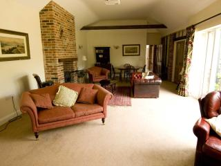 Spacious sitting room with woodburning stove