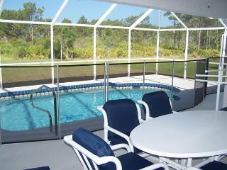 Solar heated pool / child safety guard / patio furniture
