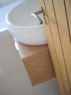 Relax and unwind in the ensuite jacuzzi bath with an assortment of free  locally made toiletries