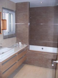 Main family bathroom with bath and shower