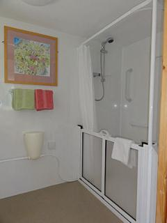 Your huge walk-in shower with double doors and floor level shower tray