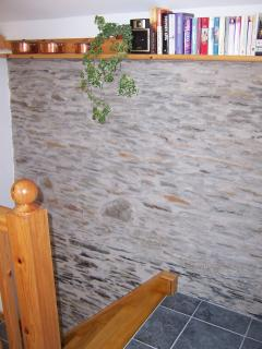 Original stone wall feature adjacent stairs to Kitchen diner