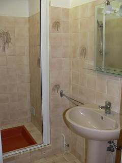 Bathroom with shower, next to seperat wc room with sink