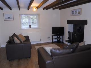 View of the Lounge seating area, wood burner, LCD TV & DVD player