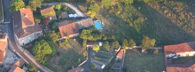 La Perdrix ~ aerial view showing the houses, pool, hangar, barn & meadow