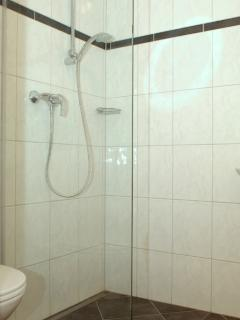 Bath room 2 is a wet floor shower room with basin & toilet