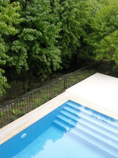 Full width steps in the secluded pool.